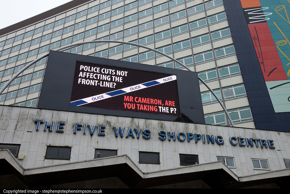 "© Licensed to London News Pictures. 08/10/2012 . Birmingham , UK . Police Federation advert outside the Five Ways Shopping Centre on Broad Street , Birmingham , which reads "" Police cuts not affecting the front-line? Mr Cameron , are you taking the P? "" . Conservative Party Conference Day 2 at the International Convention Centre . Photo credit : Joel Goodman/LNP"