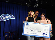 "Comedian and improv artist Wayne Brady, center, presents the winners of Charmin's ""Keep it Clean Comedy Show,"" Cristal and Heaven, with a check for $5,000.00 in honor of their performance featuring clean and clever potty humor, Tuesday, Aug. 25, 2015 in New York.  (Photo by Diane Bondareff/AP Images for Charmin)"