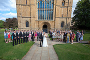 Bride & Groom and guests outside Southwell Minster