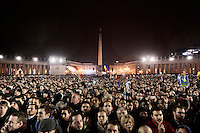 VATICAN CITY - 13 MARCH 2013: Thousands of rain-soaked faithfuls wait for the announcement of the new pope after a puff  of white smoke came out of the chimney of the Sistine Chapel, where the conclave took place, announcing to the outer world that a new Pope had been elected, in Vatican City, on March 13, 2013. The 115 cardinals picked a new pope among their midst on the second day of the conclave, choosing Jorge Mario Bergoglio from Argentina, the first South American pope to lead the church. Jose Mario Bergoglio, called Francis I, is the 266th pontiff of the Roman Catholic Church...On March 12, 2013, the 115 cardinals entered the conclave to elect a successor to Pope Benedict XVI after he became the first pope in 600 years to resign from the role. The conclave will take place inside the Sistine Chapel and will be attended by 115 cardinals as they vote to select the 266th Pope of the Catholic Church.