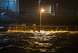© Licensed to London News Pictures. 13/01/2017. Great Yarmouth, UK. High water swamps a fence next to the River Yare at Gorleston-on-Sea near Great Yarmouth. The Environment Agency has warned residents to prepare for evacuation as as they fear flooding at tonight's high tide. Photo credit: Peter Macdiarmid/LNP