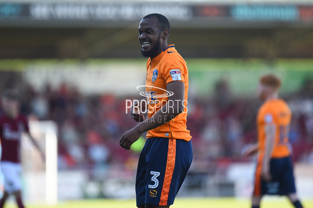 Oldham Athletic defender Wilfried Moimbe (3) has a laugh during the EFL Sky Bet League 1 match between Northampton Town and Oldham Athletic at Sixfields Stadium, Northampton, England on 5 May 2018. Picture by Dennis Goodwin.
