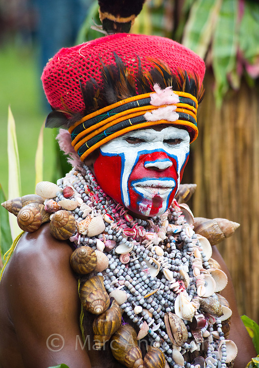 Portrait of a man from Hagen district dressed in traditional tribal outfit for the Goroka Show, an annual festival in the Papua New Guinea Highlands