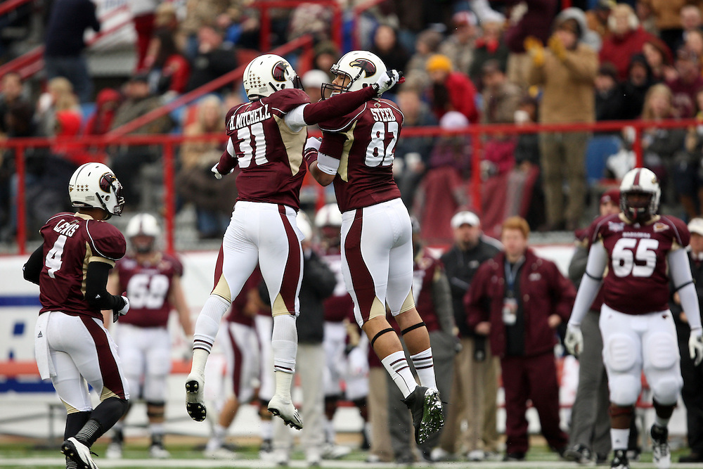 Louisiana-Monroe teammates Henry Mitchell (31) Kevin Steed (82) celebrate a sack against Ohio during the second quarter of the Independence Bowl NCAA college football game in Shreveport, La., Friday, Dec. 28, 2012.