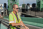 A deckhand from the ferry to Vinalhaven on the dock at the ferry terminal in Rockland, Maine.