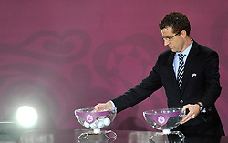 MAN WHO CHANGE THE CUPS DURING THE EUFA EURO 2012 QUALIFYING DRAW IN PALACE SCIENCE AND CULTURE IN WARSAW, POLAND..THE 2012 EUROPEAN SOCCER CHAMPIONSHIP WILL BE HOSTED BY POLAND AND UKRAINE...WARSAW, POLAND , FEBRUARY 07, 2010..( PHOTO BY ADAM NURKIEWICZ / MEDIASPORT / SPORTIDA.COM ).