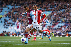 Aston Villa Defender Ryan Bertrand (ENG) shoots - Photo mandatory by-line: Rogan Thomson/JMP - 07966 386802 - 23/03/2014 - SPORT - FOOTBALL - Villa Park, Birmingham - Aston Villa v Stoke City - Barclays Premier League.