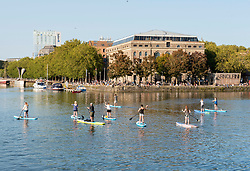 © Licensed to London News Pictures; 13/09/2020; Bristol, UK. Socially distanced paddle boarders enjoy the sunshine and hot weather at Bristol Harbourside on the last weekend before new restrictions for the coronavirus covid-19 pandemic come into law in England. From Monday 14 September it will be illegal to meet up in groups of more than six people, known as the rule of six, in order to try and contain the spread of the coronavirus. Bristol recently recorded the biggest daily increase in 10 weeks of new cases of coronavirus, and nationally, 3,539 new cases have been confirmed, the highest rise for four months. Photo credit: Simon Chapman/LNP.