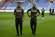 Leeds United forward Tyler Roberts (11) and Leeds United midfielder Lewis Baker (34) before the EFL Sky Bet Championship match between Wigan Athletic and Leeds United at the DW Stadium, Wigan, England on 4 November 2018.