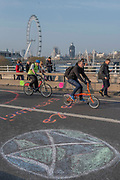 Morning on Waterloo Bridge sees the camp awake and commuters make their progress on foot and bike across the river - Day 3 - Protestors from Extinction Rebellion block several junctions in London as part of their ongoing protest to demand action by the UK Government on the 'climate chrisis'. The action is part of an international co-ordinated protest.