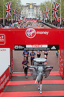 A fun-runner in an elephant costume in the finishing straight on The Mall at the Virgin Money London Marathon, Sunday 26th April 2015.<br /> <br /> Dillon Bryden for Virgin Money London Marathon<br /> <br /> For more information please contact Penny Dain at pennyd@london-marathon.co.uk