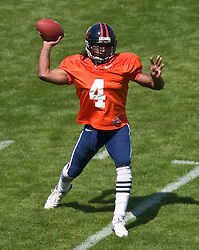 Virginia quarterback Vic Hall (4) passes during the spring game. The Virginia Cavaliers football team played the annual spring football scrimmage at Scott Stadium on the Grounds of the University of Virginia in Charlottesville, VA on April 18, 2009.  (Special to the Daily Progress / Jason O. Watson)