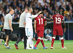 May 26, 2018 - Kiev, Ukraine - Liverpool's Egyptian forward Mohamed Salah (C) is comforted by team members and Real Madrid's Sergio Ramos (3nd L) as he leaves the pitch after injury during the UEFA Champions League final football match between Liverpool and Real Madrid at the Olympic Stadium in Kiev, Ukraine on May 26, 2018. (Credit Image: © Raddad Jebarah/NurPhoto via ZUMA Press)