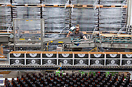The large facility where beer is made from start to finish includes a massive bottling line.  Ninkasi is a regional craft brewery making beers in the Northwest style. Their location in Eugene, Oregon affords regional access for their primary ingredients, which include: Water, Malt, Hops and Yeast. With the strong regional hop industry, and access to the McKenzie River, source of some of the cleanest water in the world, Ninkasi is well positioned for their goal of brewing high quality craft beers. The beer's namesake, Ninkasi, was the Sumerian goddess of fermentation.