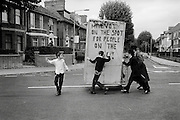 Hassidic Jewish boys push a mobile Succah through the streets of Stamford Hill during the Jewish Holiday of Succoth. London