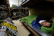 Men sleeping in a night shelter for homeless day laborers in Kamagasaki.