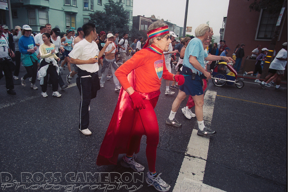 An unidentified man, costumed as a gay superhero, crests the Hayes Street hill at the 91st running of the Bay to Breakers 12K race, Sunday, May 19, 2002 in San Francisco. (Photo by D. Ross Cameron)