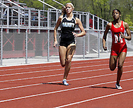 Jameela Henderson (right) runs in the second heat of the Girls 400 Meter Dash in the Buff Taylor Memorial Track & Field Invitational at the Good Samaritan Sports Plex at Trotwood Madison High School, Saturday, May 10, 2008.