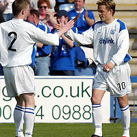 Queen of the South v St Johnstone...01.05.04  <br />Simon Donnelly celebrates his penalty strike with Mark Baxter<br /><br />Picture by Graeme Hart.<br />Copyright Perthshire Picture Agency<br />Tel: 01738 623350  Mobile: 07990 594431