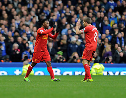 Liverpool's Daniel Sturridge celebrates his goal with Liverpool's Steven Gerrard - Photo mandatory by-line: Dougie Allward/JMP - Tel: Mobile: 07966 386802 23/11/2013 - SPORT - Football - Liverpool - Merseyside derby - Goodison Park - Everton v Liverpool - Barclays Premier League