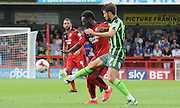 George Francomb and Roarie Deacon battle for the ball during the Sky Bet League 2 match between Crawley Town and AFC Wimbledon at the Checkatrade.com Stadium, Crawley, England on 15 August 2015. Photo by Michael Hulf.