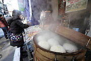 freshly made dumpling buns steaming on food stall  in Chinatown Yokohama Japan