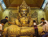 MANDALAY, MYANMAR - NOVEMBER 30, 2016 : people recovering the golden buddha of Maha Myat Muni Pagoda temple Mandalay city Myanmar (Burma)