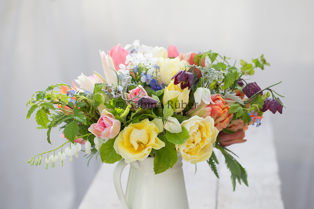 Mixed Spring flower arrangement including tulips and Fritillaria meleagris