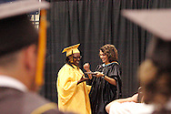 Alter principal Lourdes Lambert (right) hands out a diploma during the 47th commencement excercise of Archbishop Alter High School at Trent Arena in Kettering, Saturday, May 26, 2012.