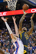 January 31, 2019; Oakland, CA, USA; Golden State Warriors center DeMarcus Cousins (0) shoots the basketball against Philadelphia 76ers forward Mike Muscala (31) during the fourth quarter at Oracle Arena.