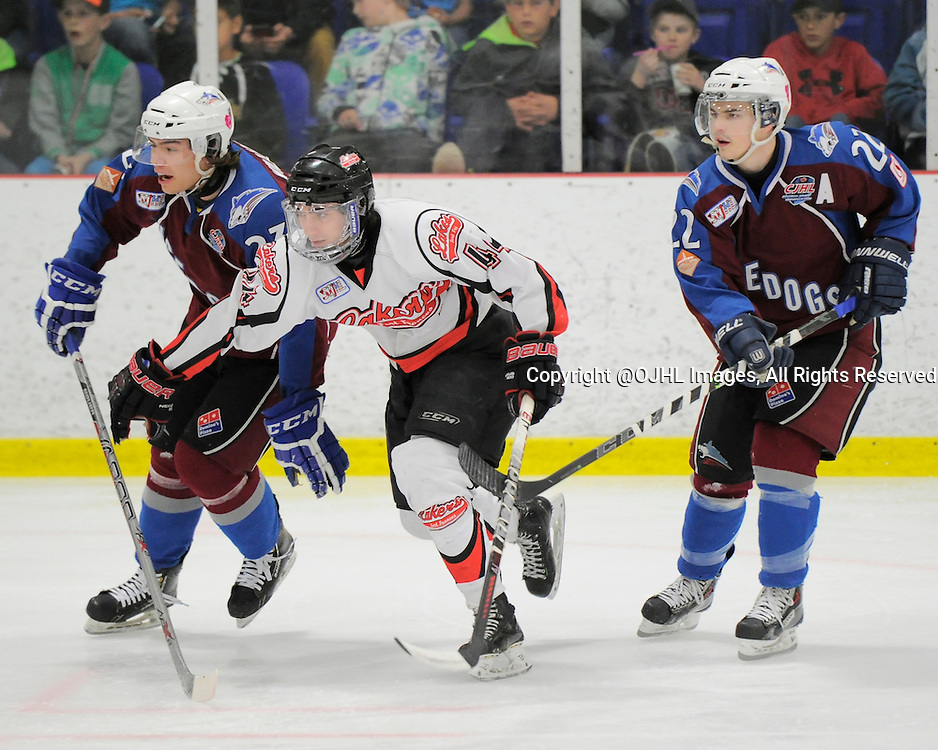 FORT FRANCES, ON - Apr 30, 2015 : Central Canadian Junior &quot;A&quot; Championship, game action between Dryden GM Ice Dogs and Fort Frances Lakers, game six of the Dudley Hewitt Cup, Dylan Robertson #44 of the Fort Frances Lakers, Troy Williams #23 and Cole Golka #22 of the Dryden GM Ice Dogs during the first period<br /> (Photo by Amy Deroche/ OJHL Images)