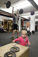 Will Lanier and Ali Hovland with her baby daughter Zoe at The Black Box crossfit gym. Shot on March 22, 2012...Photo Credit ; Rahav 'Iggy' Segev/ Photopass