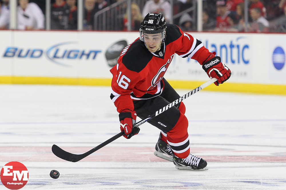 Mar 23, 2013; Newark, NJ, USA; New Jersey Devils right wing Matt D'Agostini (16) skates with the puck during the third period at the Prudential Center. The Devils defeated the Panthers 2-1.