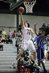 16 November 2013:  Alex Rossi gets inside of Kalmon Stokes during an NCAA mens division 3 basketball game between the Aurora University Spartans  and the Illinois Wesleyan Titans in Shirk Center, Bloomington IL