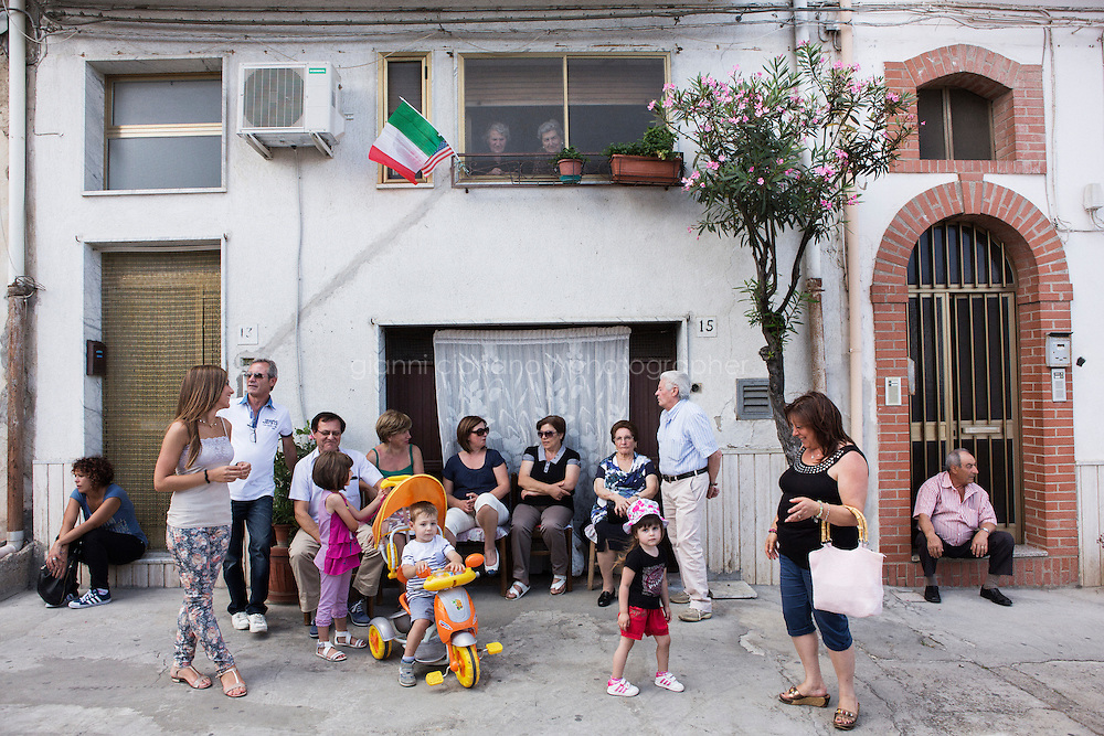 GRASSANO, ITALY - 24 JULY 2014: Local residents wait for the arrival of Mayor of New York Bill de Blasio in Grassano, his ancestral home town in Italy, on July 24th 2014.<br /> <br /> New York City Mayor Bill de Blasio arrived in Italy with his family Sunday morning for an 8-day summer vacation that includes meetings with government officials and sightseeing in his ancestral homeland.