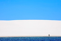 view of lagoa azul in desert sand dunes of the Lencois Maranheses National Park in brazil