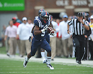 Mississippi Rebels running back I'Tavius Mathers (5) runs 56 yards for a first quarter touchdown vs. Louisiana-Lafayette at Vaught-Hemingway Stadium in Oxford, Miss. on Saturday, September 13, 2014. Ole Miss won 56-15 to improve to 3-0.