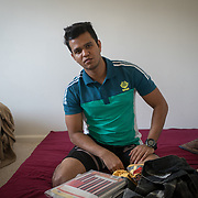 PALM SPRINGS, FLORIDA, JANUARY 14, 2018<br /> Mamudul Hasson, 21, with notebooks and items he carried with him on the mattress he sleeps on next to  his uncle in his house. Hassan is a Rohingya Muslim refugee who just arrived to the United States three weeks ago.<br /> (Photo by Angel Valentin/Freelance)
