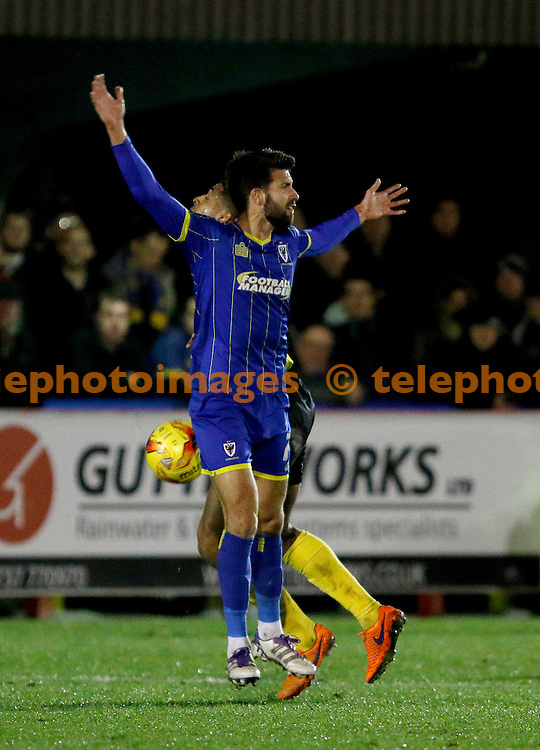 George Francomb of AFC Wimbledon appeals for the foul during the Sky Bet League 2 match between AFC Wimbledon and Dagenham and Redbridge at the Cherry Red Records Stadium in Kingston. November 24, 2015.<br /> Carlton Myrie / Telephoto Images<br /> +44 7967 642437