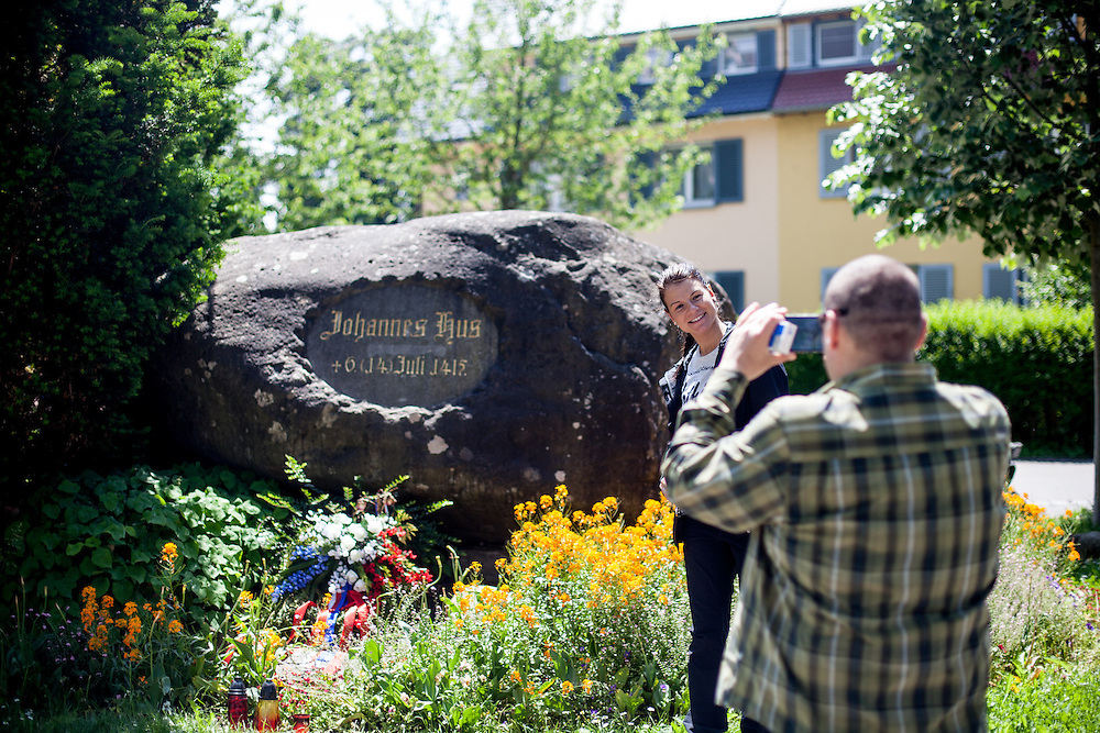 Two visitors from Czech Republic photograohing at the memorial stone. This inscribed stone in the western outskirts of Constance marks the place where Jan Hus, a Czech religious reformer, was burned at the stake in 1415. At the place of execution, he knelt down, spread out his hands, and prayed aloud. The executioner undressed Hus and tied his hands behind his back with ropes, and bound his neck with a chain to a stake around which wood and straw had been piled up so that it covered him to the neck. At the last moment, the imperial marshal, von Pappenheim, in the presence of the Count Palatine, asked Hus to recant and thus save his own life. Hus declined thusly:<br /> <br /> God is my witness that the things charged against me I never preached. In the same truth of the Gospel which I have written, taught, and preached, drawing upon the sayings and positions of the holy doctors, I am ready to die today.[