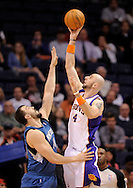 Mar. 12, 2012; Phoenix, AZ, USA; Phoenix Suns center Marcin Gortat (4) puts up a shot against the Minnesota Timberwolves center Nikola Pekovic (14) during the first half at the US Airways Center. Mandatory Credit: Jennifer Stewart-US PRESSWIRE.