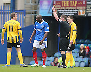 Portsmouth defender Nyron Nosworthy gets a yellow card during the Sky Bet League 2 match between Portsmouth and Shrewsbury Town at Fratton Park, Portsmouth, England on 28 March 2015.