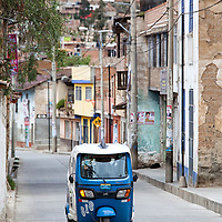 An auto rickshaw - also known as three wheeler, is one type of public transportation in Peru.