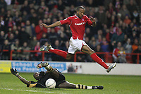 Photo: Pete Lorence.<br />Nottingham Forest v Charlton Athletic. The FA Cup. 06/01/2007.<br />Junior Agogo leaps over a tackle by Souleyman Diawara.