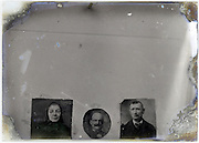 reproduction of three portraits on eroding glass plate