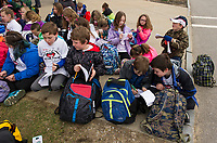 Pleasant Street School 3rd grade students write in their journals what they think may be in the time capsule before it is opened on Wednesday afternoon at Laconia City Hall.  (Karen Bobotas/for the Laconia Daily Sun)