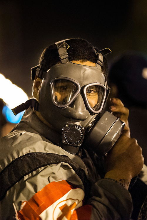 OAKLAND, CA - NOVEMBER 14, 2011: An Occupy Oakland protester readies his gas mask. The Oakland Police Department has been criticized for their use of excessive force after a tear gas canister severely injured a protester.