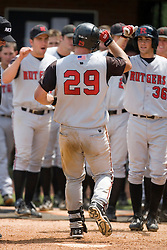 Rutgers Scarlett Knights C Frank Meade (29) is congratulated by his team after hitting a home run off of Oregon State Beavers P Jorge Reyes (23).  The Oregon State Beavers defeated the Rutgers Scarlet Knights 5-2 in Game 5 of the NCAA World Series Charlottesville Regional held at Davenport Field in Charlottesville, VA on June 4, 2007.