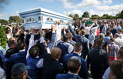 © Licensed to London News Pictures. 21/08/2018. Epsom, UK. Close family members carry the coffin at the funeral of traveller Mikey Connors in Epsom cemetery. 32 year-old Mikey Connors, the nephew of My Big Fat Gypsy Wedding star Paddy Doherty, was killed when his horse-and-cart was hit by a car in Thamesmead on July 28. Photo credit: Peter Macdiarmid/LNP