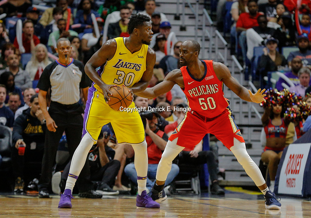 Feb 14, 2018; New Orleans, LA, USA; Los Angeles Lakers forward Julius Randle (30) is defended by New Orleans Pelicans center Emeka Okafor (50) during the second half at the Smoothie King Center. The Pelicans defeated the Lakers 139-117. Mandatory Credit: Derick E. Hingle-USA TODAY Sports